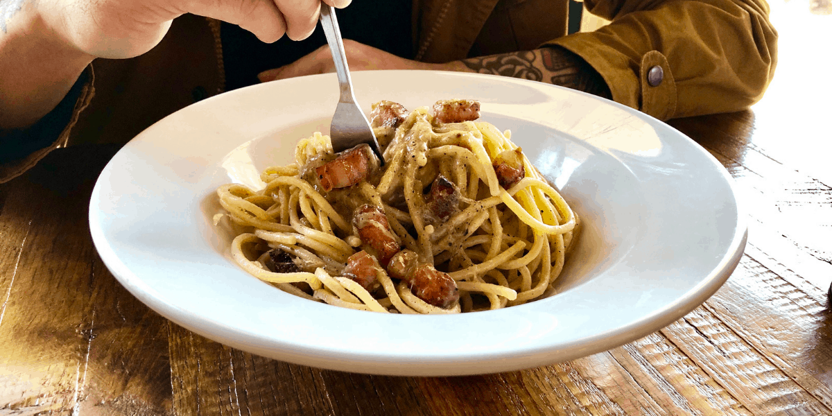 New on our menu: pasta alla gricia with guanciale on a plate